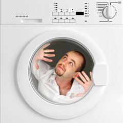 funny portrait of man inside washing machine