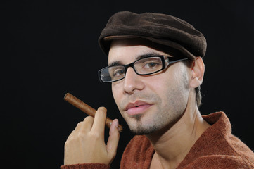 Young man holding cuban cigar