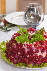 Salad with a pomegranate.