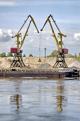 Two port cranes in river port. Rybinsk. Russia