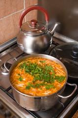 Borsch, teapot and frying pan.