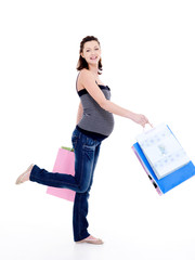 happy pregnant woman walking after shopping