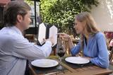 Couple looking at a menu