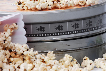 popcorn and movie isolated on white