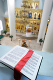 Orthodox Holy Bible on the table agains the sanctuary poster