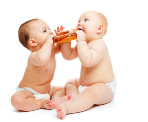 Babies eating a roll