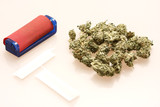 medical marijuana next to rolling papers and a cigarete roller poster