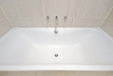 modern bath tub with designer water tap