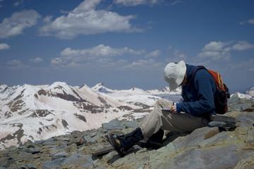 mountaintop hiker writing