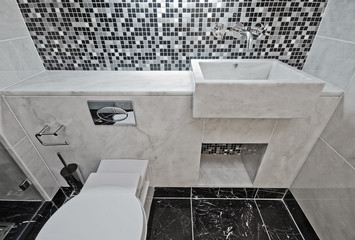 marble bathroom with mosaic tiles