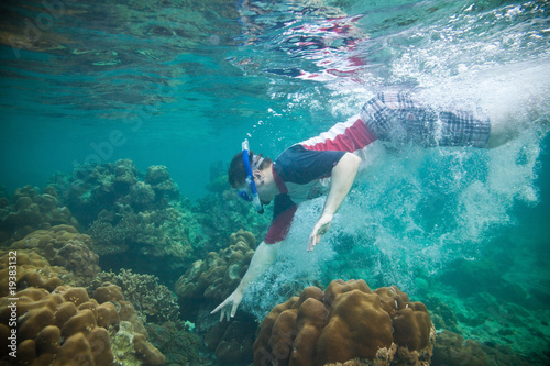 Snorkeling guy under the water