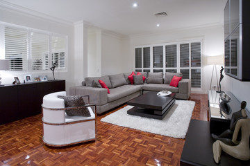Luxurious living room with wooden flooring