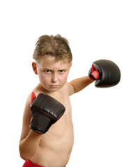 Boy in boxing gloves throws a punch
