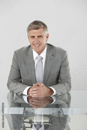 Smiling executive in his office