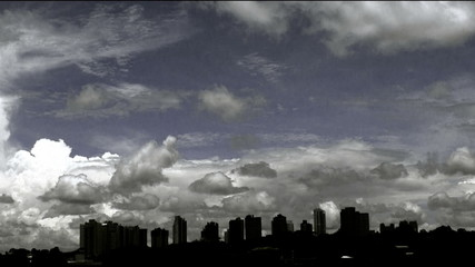 Cityscape-passing clouds