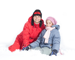 Mother with her daughter outside in snow