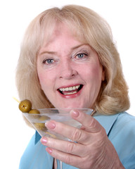 Middle aged woman holding a martini