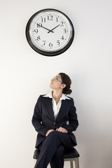 Office Worker Looking at Clock