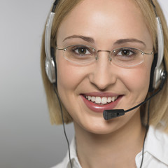 young woman with headset, smiling