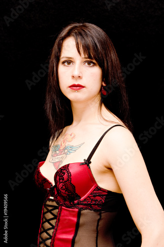 sexy brunette girl wearing corset isolated on black