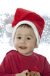 The boy clothed on Santa Claus costume
