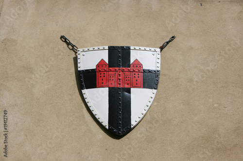 Medieval knight's shield with cross and castle as crest