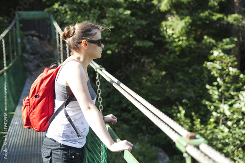 tourist girl on hanging bridge