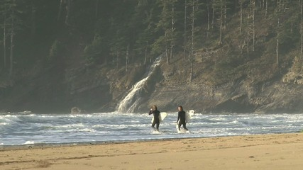 Surfers Head Out To Surf