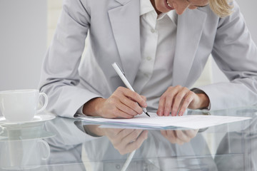 Girl signing a contract