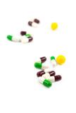 Multicolored defocused medicine pills poster