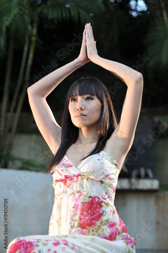 Pretty Chinese Girl doing Yoga in the Park
