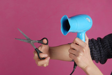 a blow dryer and scissors