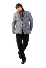 Walking Adult Fashion Boy. Studio Shoot Over White Background.