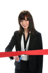 Businesswoman Cutting Red Ribbon