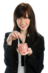 Woman Depositing Coin in Piggy Bank