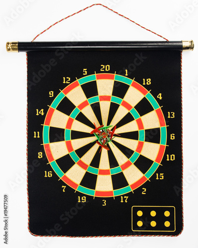 Darts set on a black sheet board