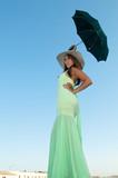 Beautiful MultiRacial model with umbrella poster
