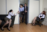 Colleagues struggle for chance be first in boss`s office. poster