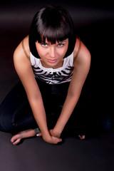 charming caucasian girl sitting on floor isolated