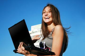 Happy smiling girl with laptop