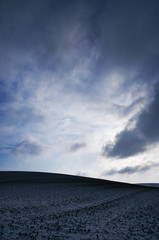 Snow cloud over hill