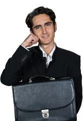 Businessman with black leathern case.