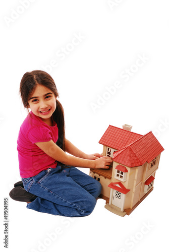 Young girl playing with house