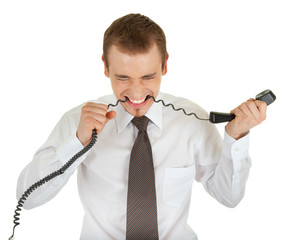 young man in a business suit and a telephone in his hand