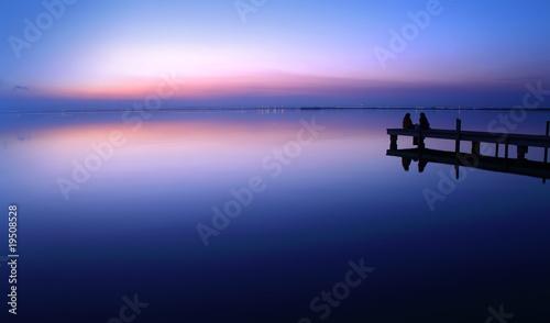 Aluminium Pier novios en la puesta de sol