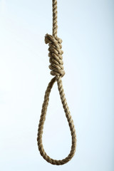 Noose made of rope against background