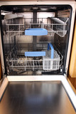 open dishwasher without dishes in kitchen poster