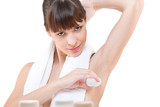 Body care: Young woman applying deodorant poster
