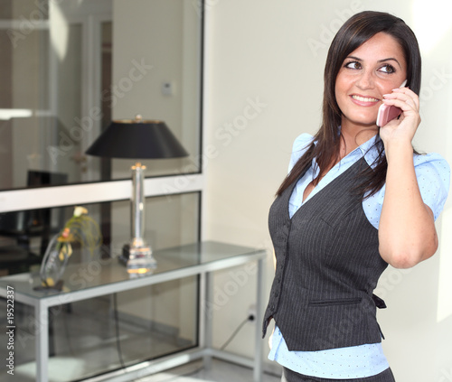 Busty Girl is phoning with a mobile cellphone