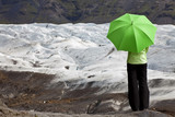 Environmental Concept Of A Woman With Green Umbrella By Glacier
